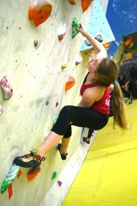 Lucy pulling hard at Youth Climbing Competition round 3